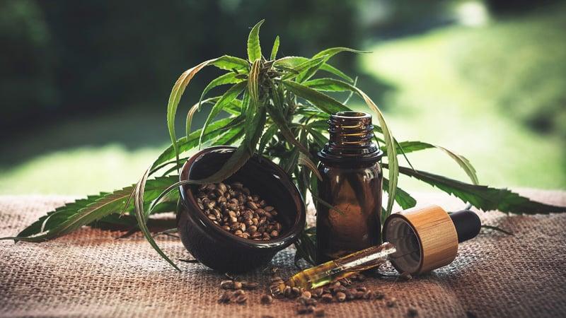 hemp cbd oil and seed on wooden table