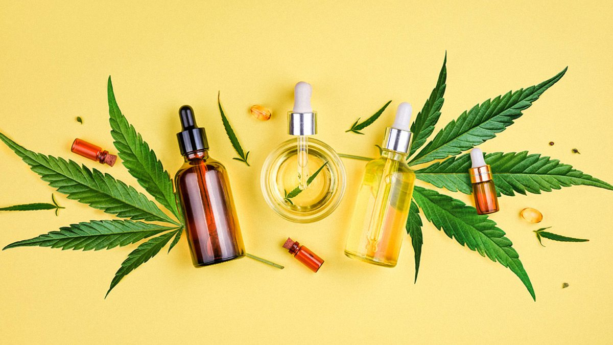 CBD oil vs. cbd capsules products on a yellow background